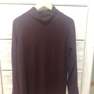 Mock neck tunic. color is a maroon/ purple